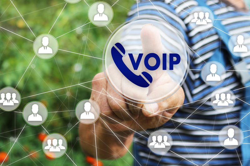 Man pointing at VoIP Systems